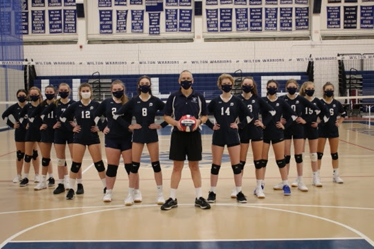 Coach Liptack and the Freshman volleyball team pose for a powerful picture.