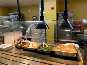 Hot meal options on September 24, 2021 at Wilton High School feature rice, chicken, and green beans.