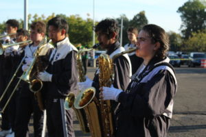"""The tenor saxophones and low brass section of the Wilton High School Band rehearse their marching show, titled """"Life on Mars""""."""